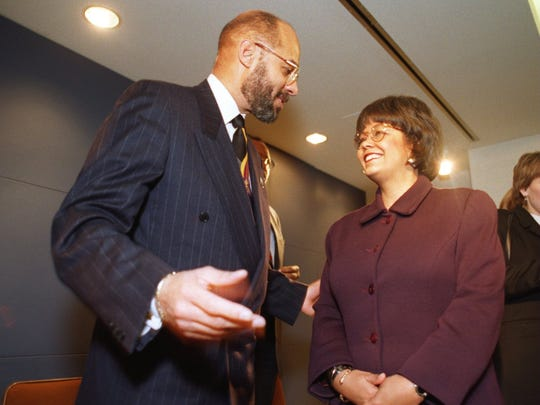 Mayor Dennis Archer talks to Beth DunCombe after announcing her election as president and CEO of the Detroit Economic Growth Corporation in February 1996.