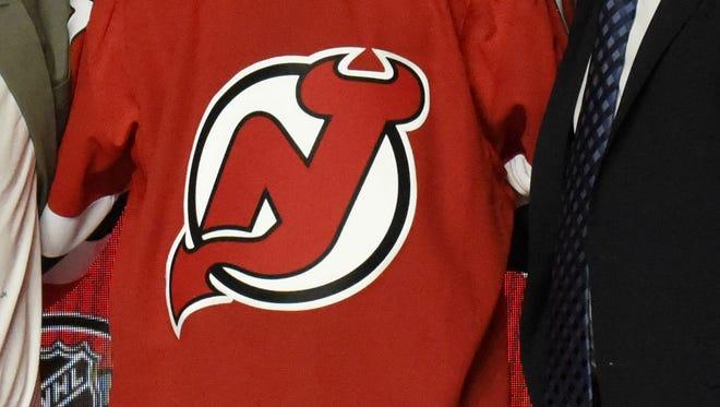 New Jersey Devils logo.