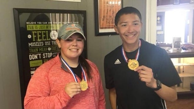Sonora's Peyton Matthews and Brian Van Winkle pose with their gold medals from the Region I-3A Tennis Tournament in Abilene on Friday, April 20, 2018.