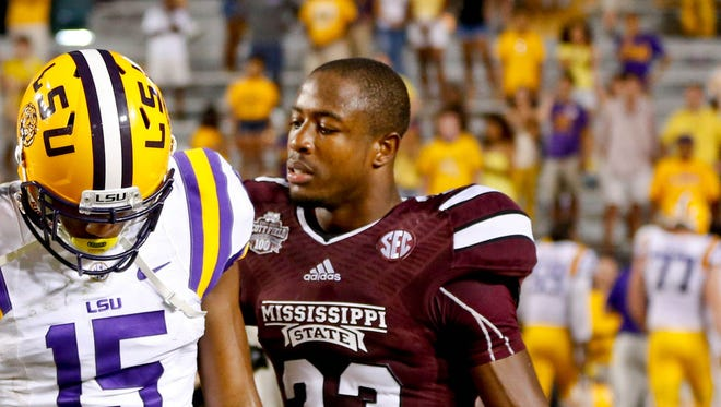 Sep 20, 2014; Baton Rouge, LA, USA; Mississippi State Bulldogs defensive back Taveze Calhoun (23) talks with LSU Tigers wide receiver Malachi Dupre (15) following the game at Tiger Stadium. Mississippi State defeated LSU 34-29. Mandatory Credit: Derick E. Hingle-USA TODAY Sports