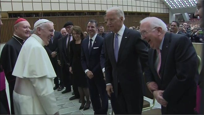 Pope Francis greets Vice President Joe Biden and others April 29 in Vatican City. Denny Sanford can be seen at the left end of the row.