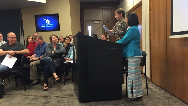 Peter McDonald, 8, shares his essay about hunting with Poudre School District's Board of Education Tuesday, May 24, 2016.