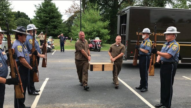 UPS employees carry the gravestone of Cpl. Fred F. Baker to Louisville Memorial Gardens.