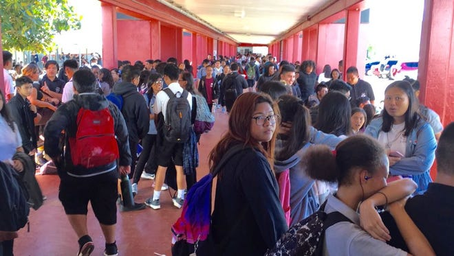 Simon Sanchez High School students fill the hallways after a lockdown was lifted on Friday, Sept. 29, 2017.