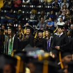 University of Southern Mississippi president Rodney D. Bennett addresses graduates during the Fall 2015 commencement Friday at Reed Green Coliseum.  The university had1,300 graduates.