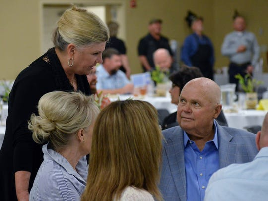 Corky Anderson, co-winner of the 2018 Tulare Farmer of the Year chats with his sister Debi Mitchell Tuesday at the International Agri-Center.