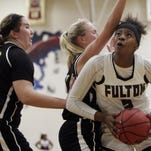 Fulton's Keke McKinney (5) goes for a shot as she's defended by Gatlinburg-Pittman's Rylie Patterson and Alexis Sanwick (30) during their game Thursday, Dec. 17, 2015, in Knoxville, Tenn.} at Fulton. Gatlinburg-Pittman won 61-58. (WADE PAYNE/SPECIAL TO THE NEWS SENTINEL)