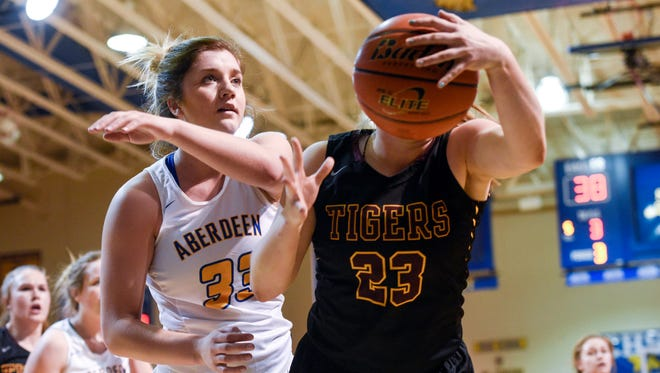 Aberdeen Central forward Paiton Burckhard (33) and Harrisburg's Faith Van Holland (23) fight for a loose ball during their high school basketball game at Aberdeen Central on Feb. 16, 2018. Aberdeen beat Harrisburg 57-35 to win the Eastern South Dakota Conference title.