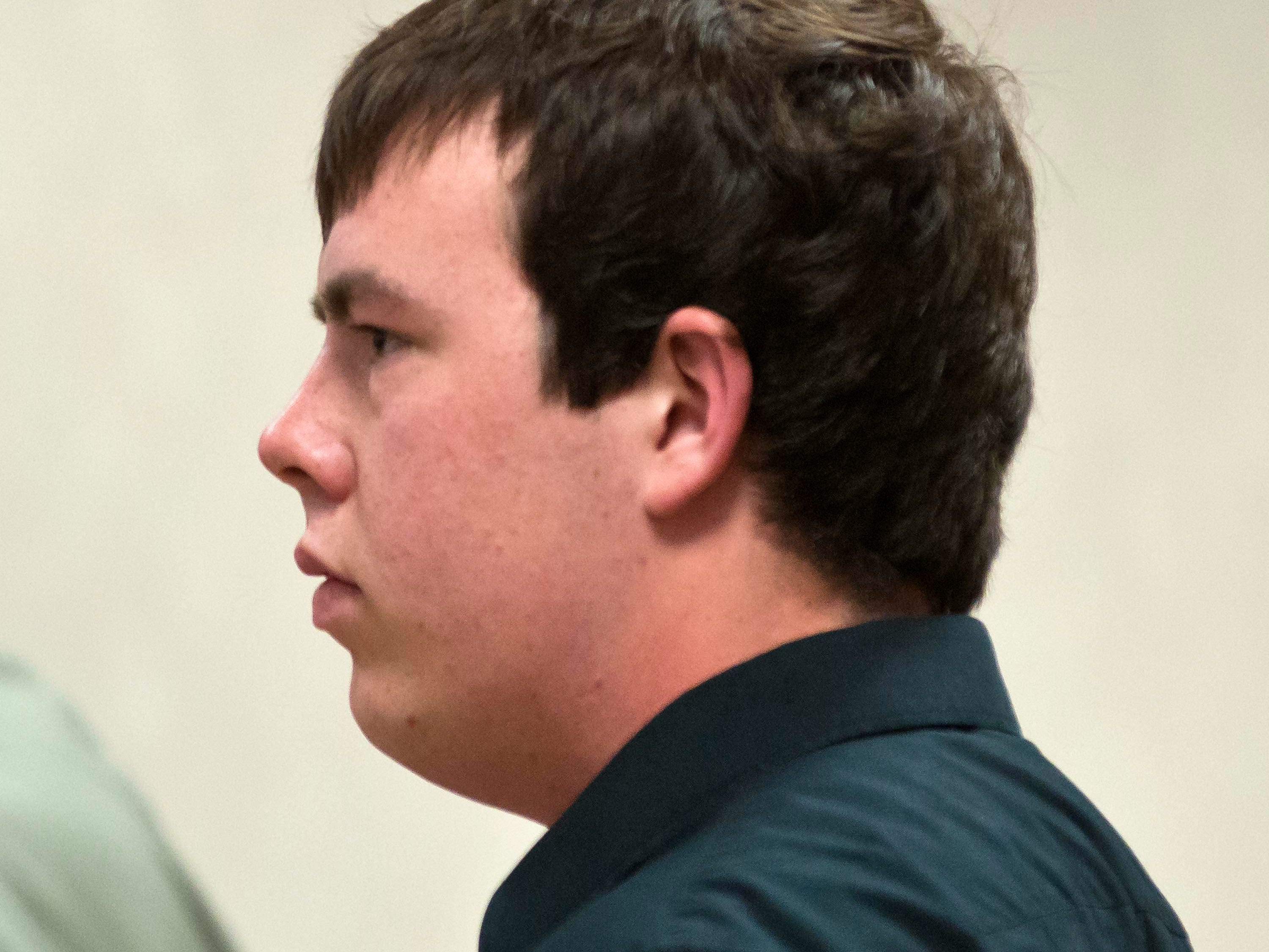 Brian Lasell, one of five former Milton High School football players accused of hazing, pleads not guilty to a charge of simple assault in Vermont Superior Court in Burlington on Tuesday. Also accused are Ryan Carlson, Brandon Belliveau, Colby Darling and William Jenkins. Carlson and Jenkins are out of state and did not appear at their arraignments.