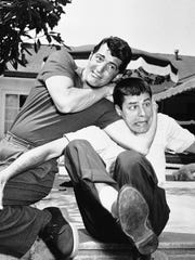 Dean Martin, left, and Jerry Lewis are wrestling for