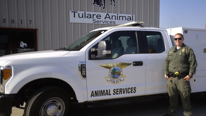 Tanner Grewe drives one of two new animal control vehicles. the vehicles are equipped with cooling systems to keep animals safe during hot days.