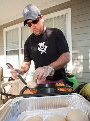 Competitive barbecuer Josh Cooper demonstrates some