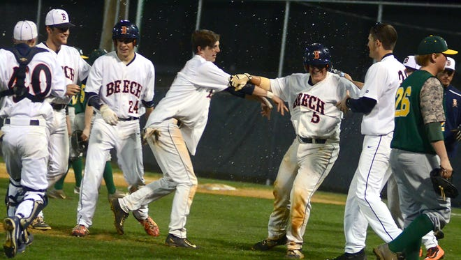 Teammates celebrate with Beech High junior Ryan Mortensen (5) after his game-winning single during Tuesday evening's 4-3 victory over Gallatin.