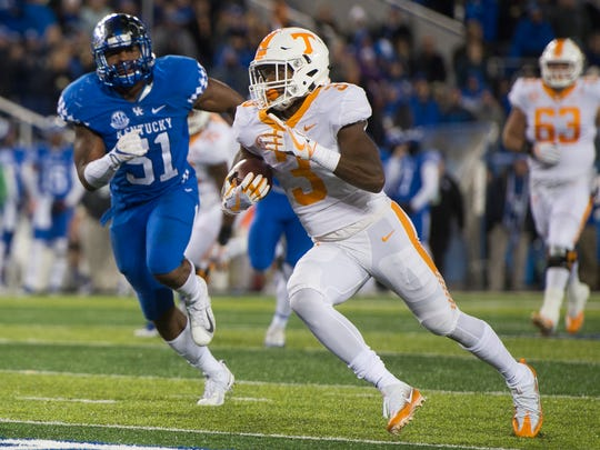 Tennessee running back Ty Chandler (3) runs with the ball during Tennessee's game against Kentucky at Kroger Field in Lexington on Saturday, Oct. 28, 2017.