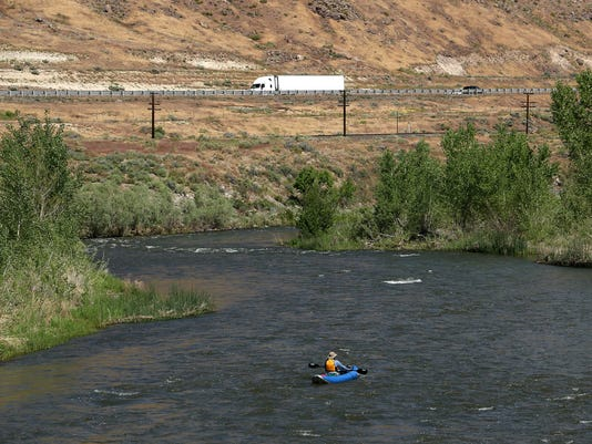Kayaker floats Truckee River east of Sparks.jpg