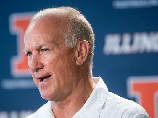 Bill Cubit speaks after being named the interim coach of the Illinois football team, at a news conference Friday, Aug. 28, 2015, in Champaign, Ill. Cubit was named interim coach as Illinois abruptly fired coach Tim Beckman on Friday, one week before the start of the season, saying preliminary results of an investigation found some truth to allegations of player mistreatment and inappropriate behavior. (Robin Scholz/The News-Gazette via AP) MANDATORY CREDIT