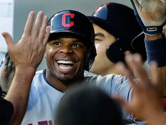Cleveland Indians' Rajai Davis smiles in the dugout after he hit a solo home run in the fifth inning of a baseball game against the Seattle Mariners, Monday, June 6, 2016, in Seattle. (AP Photo/Ted S. Warren)