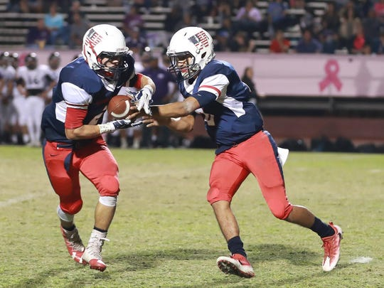 Tulare Western quarterback Andre Aguilar hands the