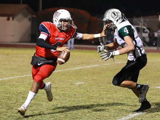 Tulare Western's Andre Aguilar (8) scrambles past Tehachapi's