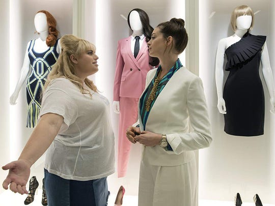 "Rebel Wilson, left, and Anne Hathaway in ""The Hustle."""