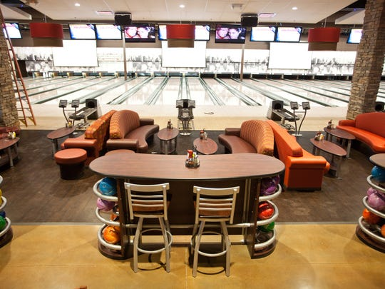 Get a $10 game card or free small wings at Uptown Alley.