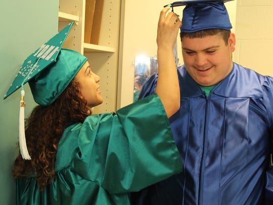 Yomarys Suarez of Kingston and Tyler Nickolich of Saugerties were among 25 gradutes of the Ulster BOCES Center for Special and Alternative Education Friday.