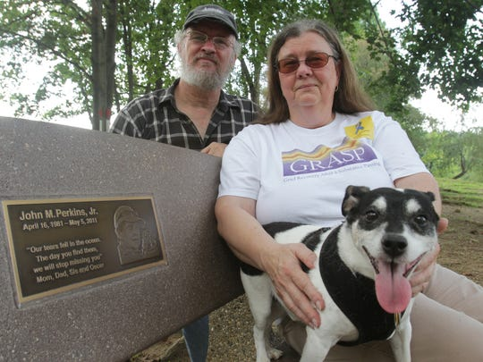 Marty and Liz Perkins at the bench at the dog park in Carousel Park dedicated to their son, John, who died of a heroin overdose.