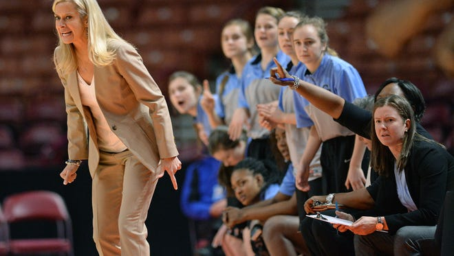 Toni Leopard, left, has resigned after four seasons as girls basketball coach at Christ Church.