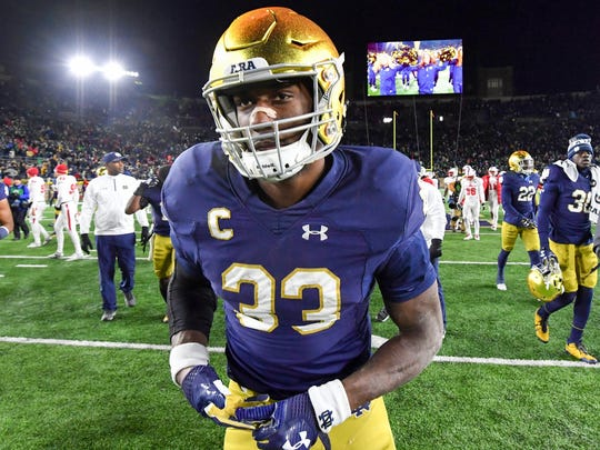 Notre Dame Fighting Irish running back Josh Adams (33) leaves the field after Notre Dame defeated the North Carolina State Wolfpack at Notre Dame Stadium.