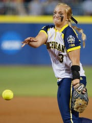 Michigan's Megan Betsa pitches against LSU in the Women's College World Series at ASA Hall of Fame Stadium in Oklahoma City, Friday, June 3, 2016.