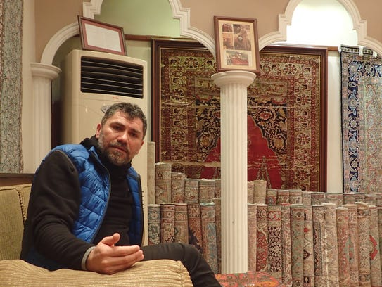 Carpet seller Oscar Raci said sales are down 90% since