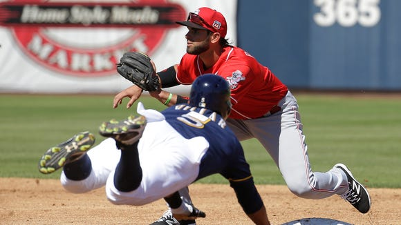 The Reds' Jose Peraza waits for the throw as the Brewers' Jonathan Villar dives to second during the second inning of a spring training baseball game on Friday, March 18, 2016, in Phoenix.