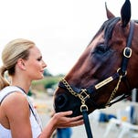 Miss Kentucky Katie George and American Pharoah took some pictures together on Friday morning at the backside of Churchill Downs.  American Pharoah will try to win the Triple Crown next weekend and George will be trying to win the title of Miss USA in July.  May 29, 2015