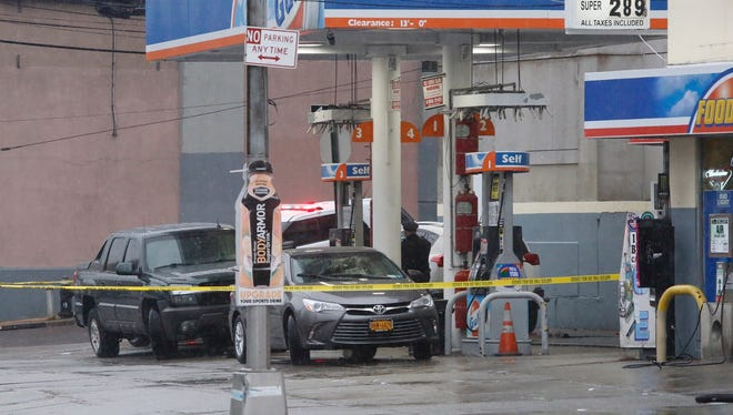 Gulf gas station at Bronx Boulevard and East 234th Street in the Bronx where a car being pursued by Mount Vernon police crashed into a barrier, Tuesday, Feb. 7, 2017. The car is not visible. Police shot a female passenger in the car in the shoulder when she got out of the car and tried to flee.