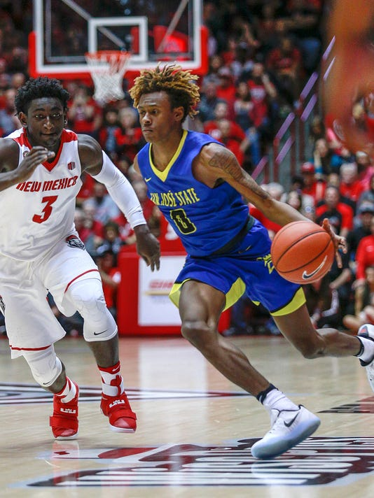 San Jose State's Terrell Brown (0) drives against New Mexico's Jordan Hunter (3) during the second half of an NCAA college basketball game in Albuquerque, N.M., Saturday, Feb. 4, 2017. San Jose State won 78-68. (AP Photo/Juan Antonio Labreche)