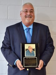 John J Brunetti Jr. received an award on behalf of