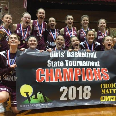 The Mount Abraham girls basketball team celebrates