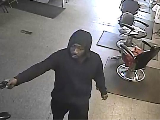 A photo of one of the two assailants in a robbery of