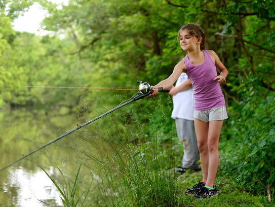 Emma-Jean Axe, 8, of Windsor Township, fishes from