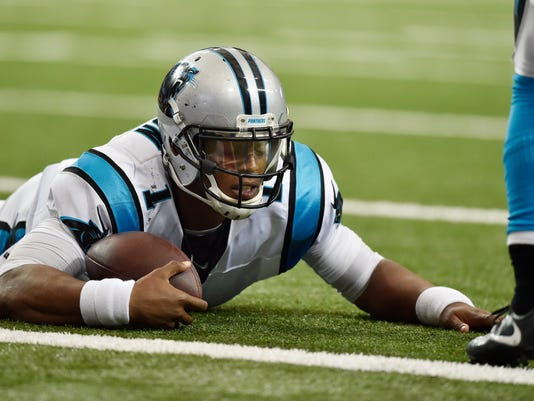 FILE - In this Oct. 2, 2016, file photo, Carolina Panthers quarterback Cam Newton (1) lies on the turf after being hit against the Atlanta Falcons during the second half of an NFL football game in Atlanta. Newton was not at the start of practice for the second straight day while dealing with a concussion. (AP Photo/Rainier Ehrhardt, File)