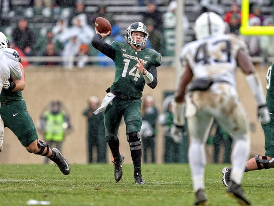 Michigan State quarterback Brian Lewerke  throws the