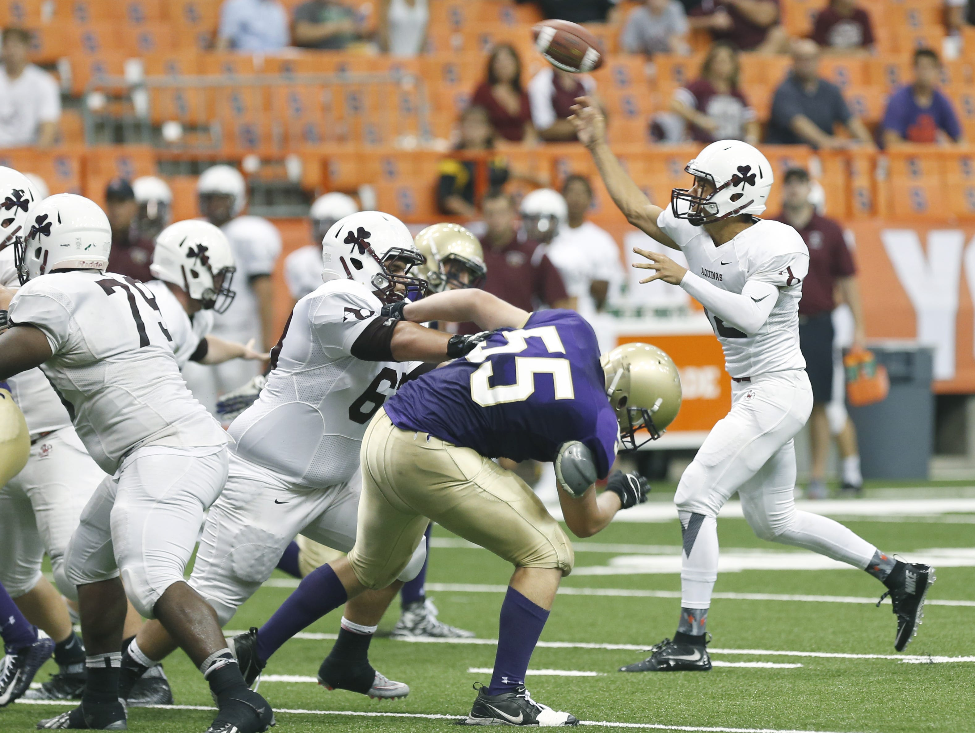 Aquinas senior Jake Zembiec, shown here throwing a pass In Week 1 inside the Carrier Dome, threw four touchdown passes against Buffalo Saint Francis Sept. 26.