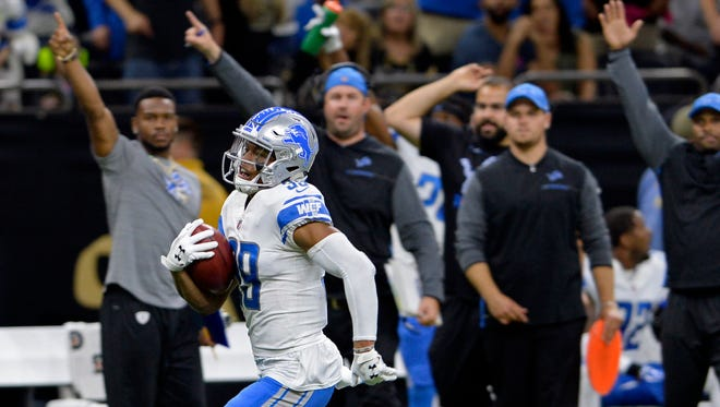 Lions' Jamal Agnew returns a punt for a touchdown in the fourth quarter against the Saints in New Orleans, Sunday, Oct. 15, 2017.