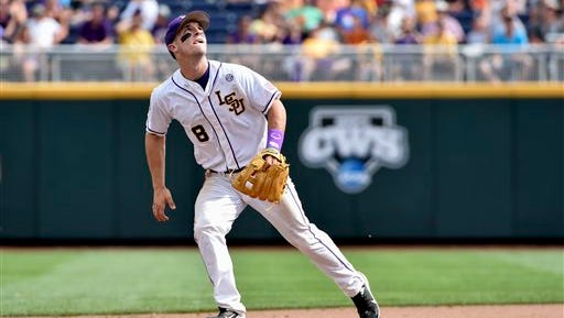 LSU shortstop Alex Bregman (8) follows the trajectory of a ball hit by TCU in the seventh inning of an NCAA College World Series baseball game at TD Ameritrade Park in Omaha, Neb., Sunday, June 14, 2015. (AP Photo/Mike Theiler)