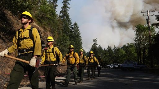 Department of Forestry firefighters prepare for work at the Cable Crossing Fire, Tuesday, July 28, 2015, near Glide.