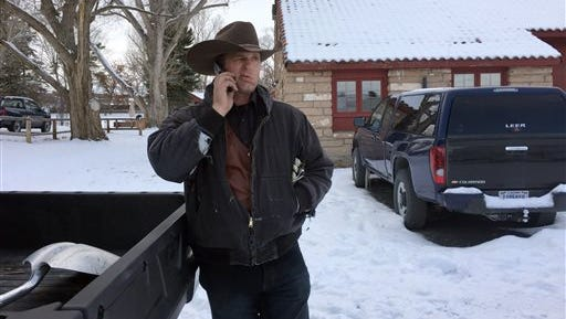 Ryan Bundy talks on the phone at the Malheur National Wildlife Refuge near Burns, Ore., Sunday, Jan. 3, 2016. Bundy is one of the protesters occupying the refuge to object to a prison sentence for local ranchers for burning federal land. (AP Photo/Rebecca Boone)