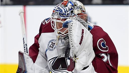 Colorado Avalanche goalie Calvin Pickard makes a glove save during the second period of the team's NHL hockey game against the Los Angeles Kings, Wednesday, Jan. 27, 2016, in Los Angeles. (AP Photo/Mark J. Terrill)