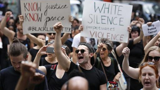 Protesters march during a Black Lives Matter demonstration in New York, Sunday, July 10. A crowd of about 300 people protested the shootings of black men by police officers.