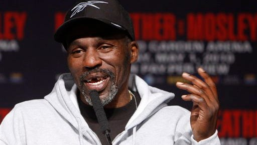 Boxer Floyd Mayweather Jr.'s trainer, Roger Mayweather, speaks during a news conference at the MGM Grand Wednesday, April 28, 2010 in Las Vegas. Floyd Mayweather will challenge Shane Mosley for his WBA welterweight title on Saturday, May 1.