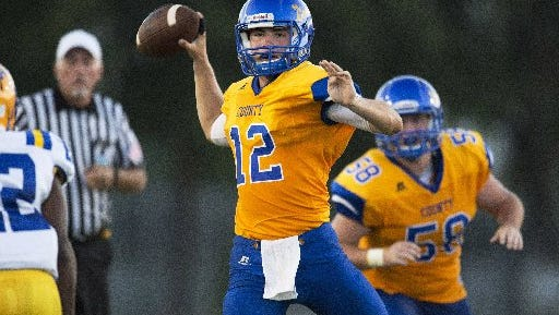 Martin County's quarterback Austin Kuyrkendall (12) sets up to throw a pass in the first half of their game against Auburndale at Martin County High School in Stuart on Aug. 19, 2016..